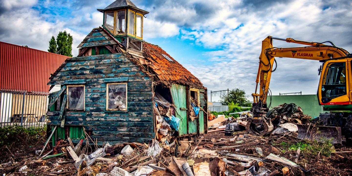 Image of a shack, in the process of being demolished...